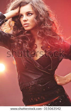 Glamorous girl in black leather jacket and lace tanktop - stock photo