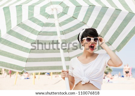 glamorous girl in retro style by color umbrella - outdoors
