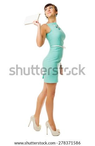 Glamorous girl in turquoise dress with handbag isolated - stock photo