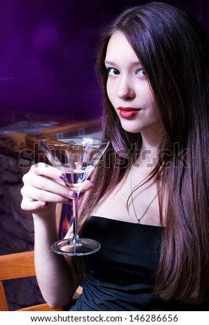 Glamorous girl with glass of martini