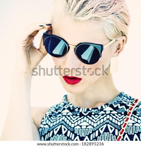 Glamorous photo girl in stylish glasses - stock photo