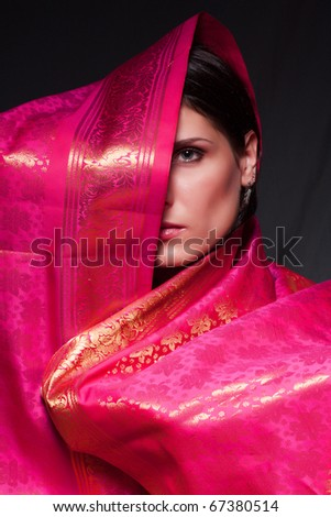 glamorous portrait of a beautiful young woman in a sari dress (Dark Key) - stock photo