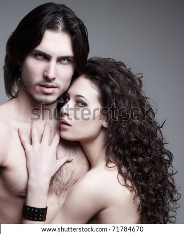 glamorous portrait of a pair of vampire lovers - stock photo