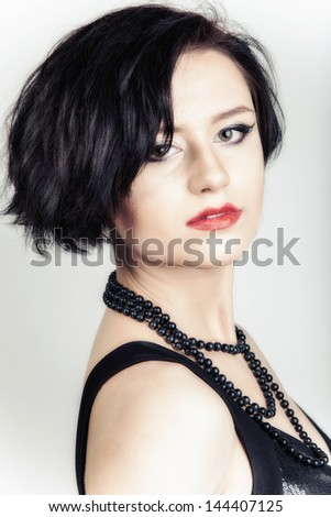 Glamorous portrait of young beautiful brunette woman