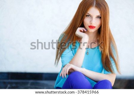 glamorous portrait of young beautiful woman in bright clothes. red lips. Summer portrait of a beautiful young Caucasian girl with red straight hair. fashion portrait. woman portrait - stock photo