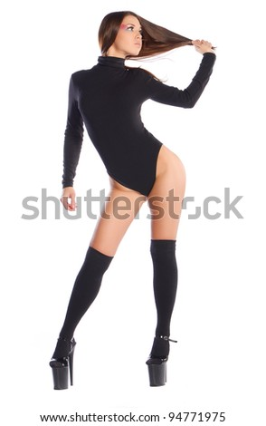Glamorous standing woman in black lingerie - stock photo