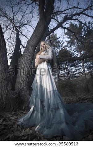 glamorous vampire in the woods - stock photo