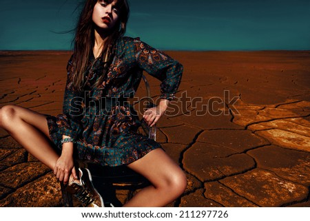 Glamorous woman in dress - stock photo