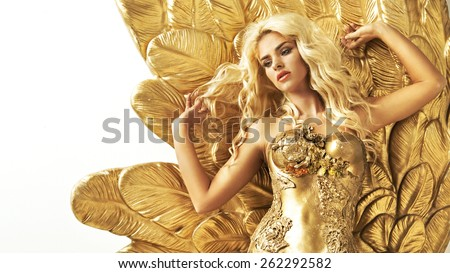 Glamorous woman in gold - stock photo