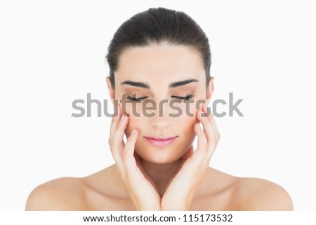 Glamorous woman touching her chin while looking natural - stock photo