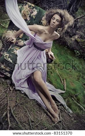 Glamorous woman wearing beautiful dress - stock photo
