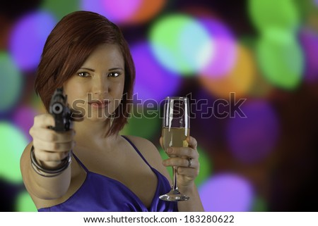 Glamorous woman with a gun. Spy. - stock photo