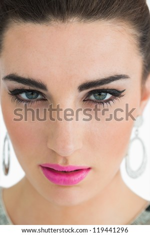 Glamorous woman with pink lips pouting - stock photo