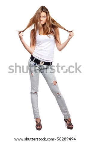 Glamorous young woman in shirt and jeans on white background - stock photo