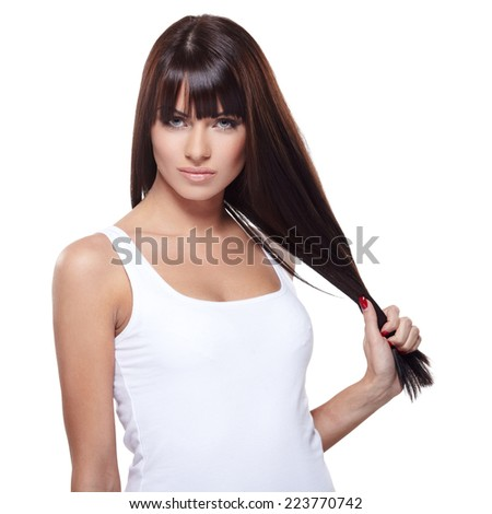 Glamorous young woman in white shirt on white background - stock photo