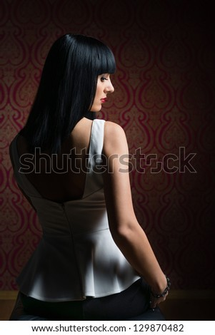 Glamour brunette girl with shiny hair. View from behind - stock photo