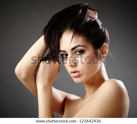 Glamour closeup studio portrait of a young woman - stock photo