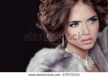 Glamour. Fashion girl Model wearing in Luxury Mink Fur Coat isolated black background. - stock photo