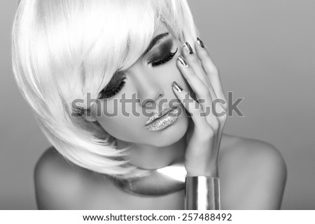 Glamour Fashion Woman Portrait. Blond girl with White Short Hair Isolated on Grey Background.  Hairstyle. Fringe. Face Close-up.Vogue Style. - stock photo