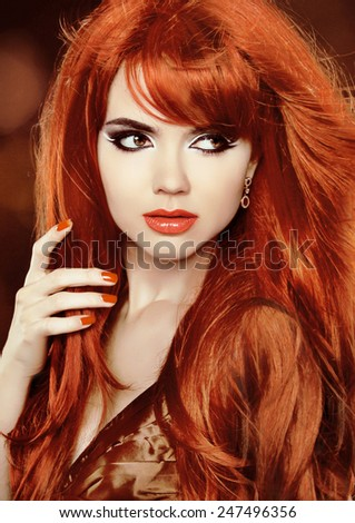 Glamour Fashion Woman Portrait. Red Hair. Healthy Long Hair. Beauty Model Girl. Hairstyle.  - stock photo