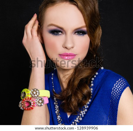 glamour girl with bright make-up-and bracelet on black - stock photo