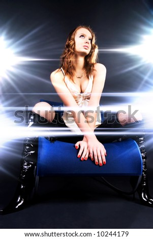 Glamour model superstar. Bright glazing flashes light. - stock photo