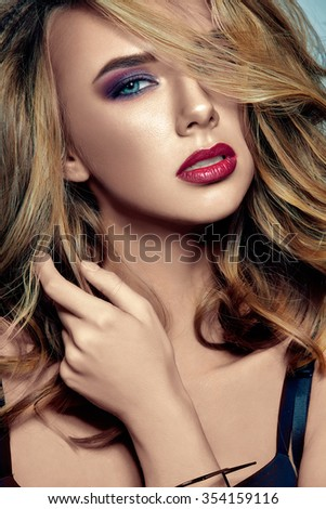 Glamour portrait caucasian beauty girl with red lips and provocative make up. Luxury woman with blue eyes. Natural blond hair with romantic wavy hairstyle. Retouched image.	 - stock photo
