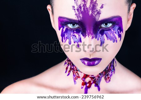Glamour portrait of beautiful woman model with bright purple makeup - stock photo