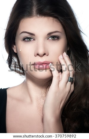Glamour portrait of beautiful woman model with fresh daily makeup and romantic wavy hairstyle. Fashion shiny highlighter on skin, sexy gloss lips make-up and dark eyebrows. tears - stock photo