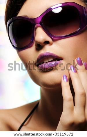glamour portrait of beautiful young woman in big violet fashion sunglasses