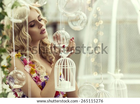 Glamour portrait of blond woman with baubles - stock photo