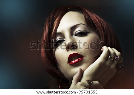 Glamour portrait of sexy woman face with bright evening make up for party and jewelry gold rings with precious stones