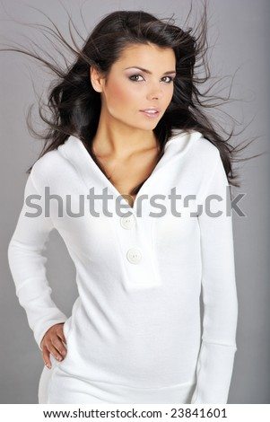 Glamour Portrait of sexy woman on grey background - stock photo