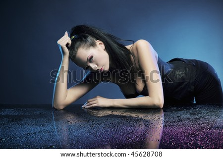Glamour woman over blue background - stock photo