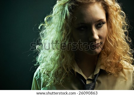 Glamour woman portrait in shirt and tie, with specific light and look. - stock photo