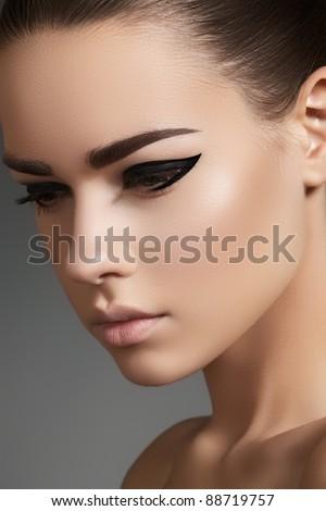 Glamourous closeup female portrait. Fashion evening elegance eyeliner makeup on model eyes. Cosmetics and make-up - stock photo