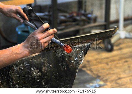 glasblower at work - stock photo