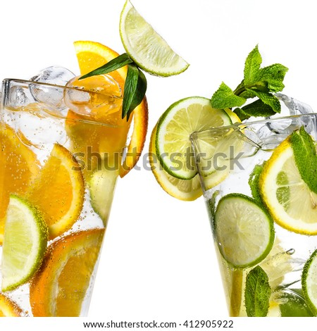 Glases of frozen cocktail mojito on white background