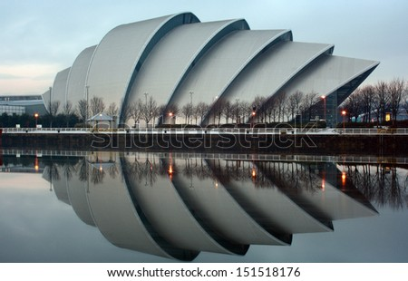 GLASGOW, SCOTLAND - DECEMBER 25: The Clyde Auditorium reflecting on the River Clyde on December 25, 2010 in Glasgow, Scotland. The Clyde Auditorium was completed in 1997. - stock photo