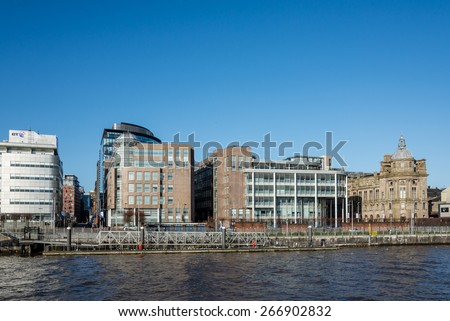 GLASGOW, SCOTLAND - MARCH 08: Modern office buildings on banks of the River Clyde at Atlantic Quay on March 08, 2015 in Glasgow, Scotland.