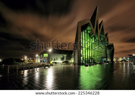 GLASGOW, SCOTLAND - OCTOBER 10: a long exposure of the Riverside Transport Museum reflecting on the rain soaked ground on October 10, 2014 in Glasgow, Scotland.