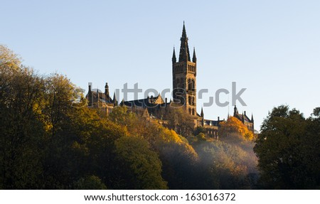 Glasgow University main building in the morning sun and mist - stock photo