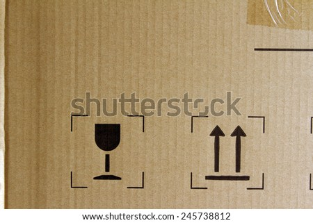 Glass and arrows signs on cardboard - stock photo
