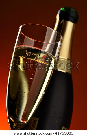 Glass and bottle of champagne close up