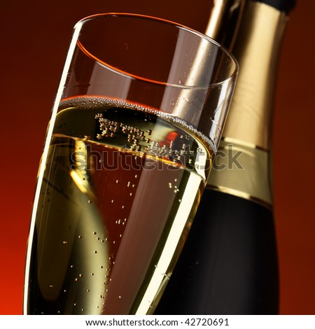 Glass and bottle of champagne close up - stock photo