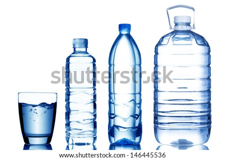 Glass and bottle of water with various size - stock photo