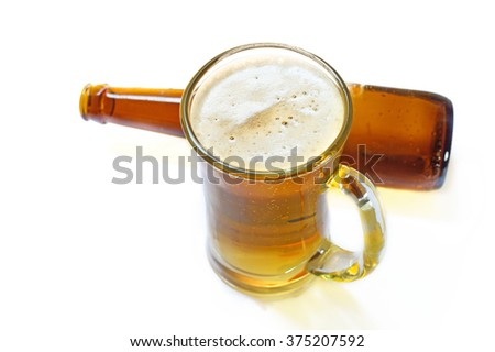 Glass and bottle  with beer on white background  - stock photo