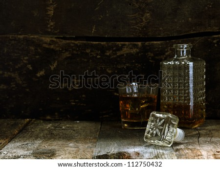 Glass and Carafe of Bourbon or Whisky with more room for individual composition - stock photo