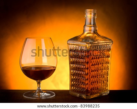 glass and luxury bottle of liquor - stock photo