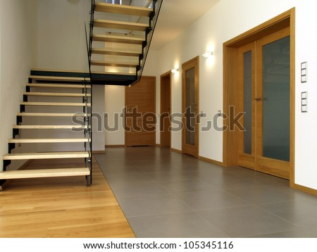 Glass and wooden stairs in the modern house interior - stock photo